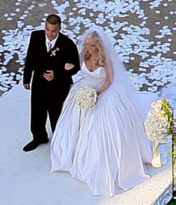 Kendra Wilkinson walks down the aisle with brother Colin, L.A