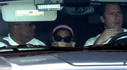 Paris, escorted by Janet Jackson, arrived wearing sunglasses